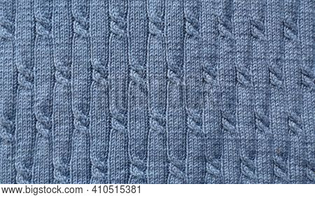 Knit Pattern. Close-up Of Knitted Wool Texture. Blue Pattern Knit As Background.