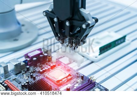 automatic arm installing a computer chip with cpu