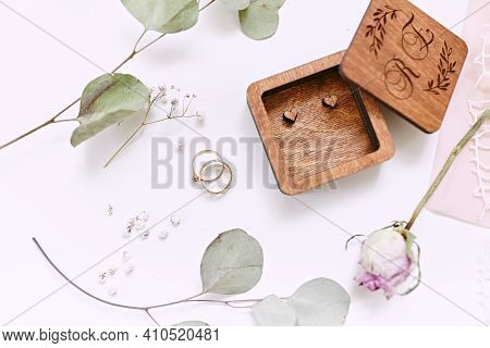 Wooden Box. Engagement Rings On White Background. Wedding Details. Eucalyptus And Rose