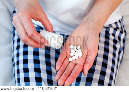 Woman Pouring Pills From A Bottle Into Her Hand. Taking Vitamins, Supplements, Antibiotic, Antidepre
