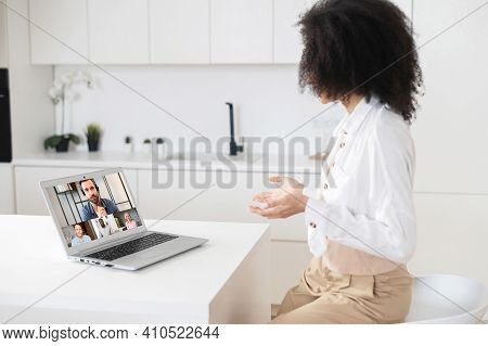 Team Of Coworkers Involved In Webcam Video Conference Call, Led By Mature Male Ceo, Brainstorming, R