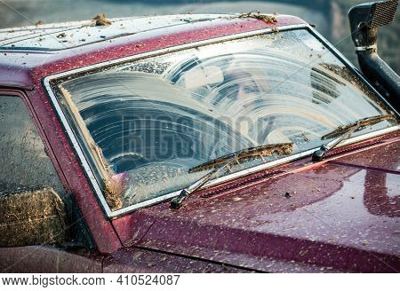 windshield of dirty offroad car