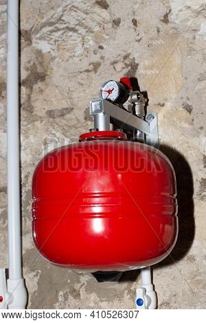An Expansion Tank For The Water Heating System To Regulate The Volume Of The Coolant. Heating Of A P