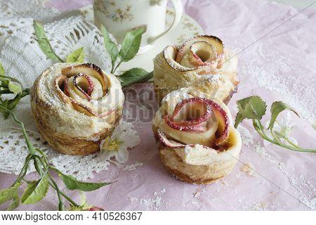 Apple Strudel Dessert In Rose Shape On Pink Background. Rose Shaped Apple Baked Dessert.