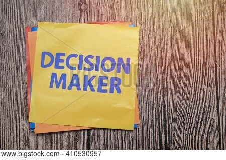 Decision Maker, Text Words Typography Written On Paper Against Wooden Background, Life And Business