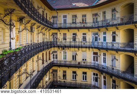 Budapest, Hungary, March 2020, View Of The Building Courtyard At Nyugati Tér 4 With Balconies And Ba