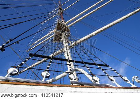 Rigging And Mast Of A Large Sailing Ship. Ropes And Pulleys For Tensioning Sails.