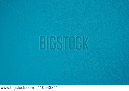 Photo Of A Blue Painted Wall. Turquoise Or Blue Wall Background.