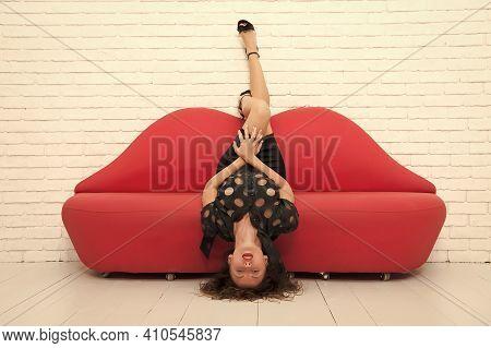 Softer Than Silk. Fashion Model Has Sexy Smooth Legs. Sexy Woman Resting On Sofa. Beautiful Girl Lyi