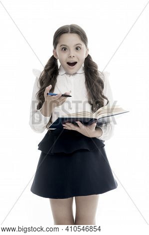 Schoolgirl With Surprised Look Isolated On White. Little Child Hold Book With Pen. Back To School. H