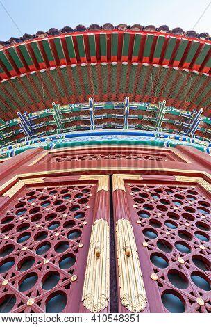 Beijing, China - April 29, 2010: Temple Of Heaven. Closeup Of Red-golden Entrance Door Into Circular