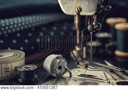 Working Part Of Antique Sewing Machine With Spools Of Threads, Shuttle, Measuring Tape, Sewing Needl