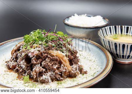 Beef Bulgogi Bbq Meat Served With Rice Bowl And Miso Soup With Beautiful Presentation On The Plate.