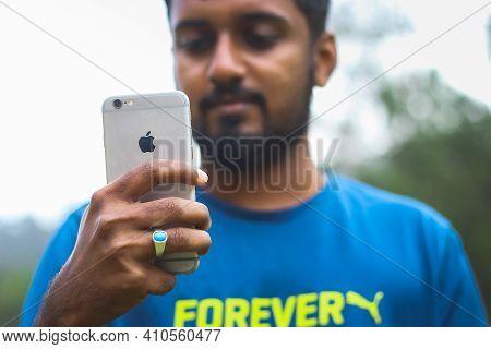 Kodaikanal, India - 21-feb-2021: Asian Man Using Iphone Mobile On Outdoor. Men Model Editorial Stock