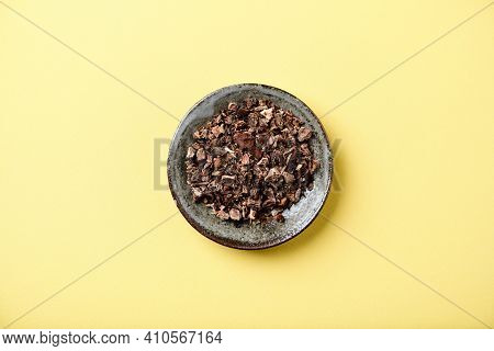 Dry Root Of Rhodiola Rosea. Golden Root, Rose Root. Healthy Medical Plant On Yellow Background. Top