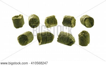 A Set Of Green Granulated Hops. Isolated On A White Background