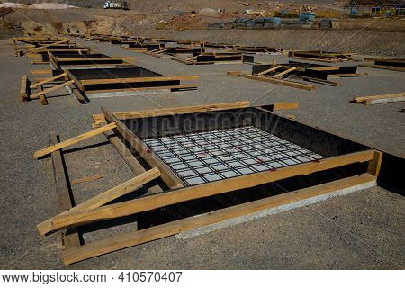 Formworks Made Of Plywood And Lumber For Cast In Place Concrete Foundations. Row Of Concrete Foundat