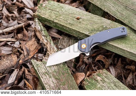 A Knife With A Chopped-off Blade. A Knife With A Wide Blade. Rough Pocket Knife On An Old Tree. Top.
