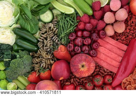 High fibre food for a healthy digestive system with fruit, vegetables, legumes and pasta. High in antioxidants, anthocyanins, vitamins, mineral, lycopenes and protein. Health care concept. Top view.