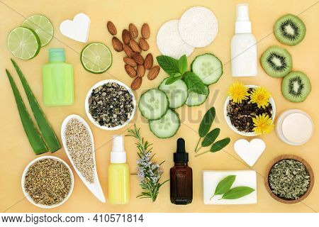 Natural health care for skin treatments with ingredients used to treat skin ailments including sunburn, acne, psoriasis, eczema and helps to reduce environmental damage. Flat lay on mottled yellow.