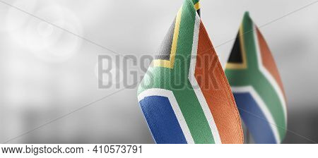 Small National Flags Of The South Africa On A Light Blurry Background