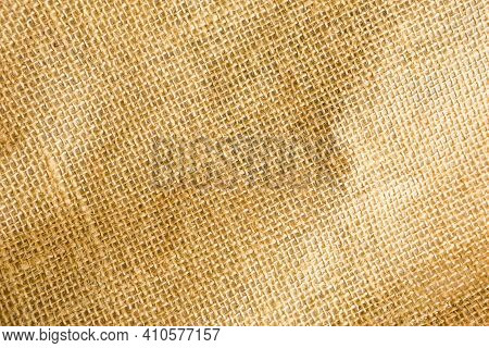 The Texture Of Burlap, Rough Weave In A Cage Made Of Natural Fiber, Yellow-brown Color. Copyspace, C