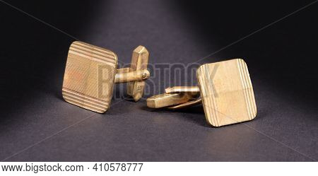 Old Gilded Cufflinks, Isolated On Dark Background (with Shadow)