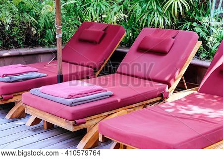 Many White Chaise Lounge By The Pool