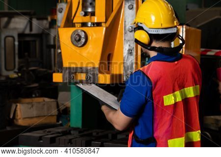 Skillful Factory Worker Or Engineer Do Machine Job In Manufacturing Workshop . Industrial People And