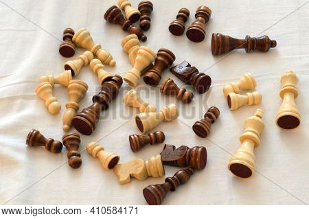 Chess Pieces On A White Background Close Up.