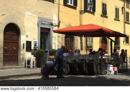 Firenze, Italy - April 21, 2017: People Eating In Santo Sprito Square, Florence, Firenze, Tuscany, I