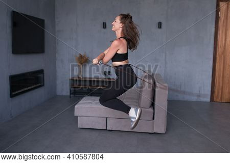Fit Woman With Jump Rope At Home Doing Skipping Workout.