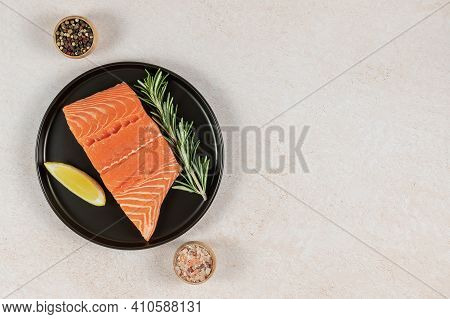 Top View Of Fresh Raw Atlantic Salmon. Great Source Of Omega-3 Fatty Acids, Protein, Potassium, And