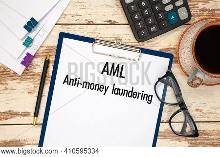 Paper With Anti-money Laundering Aml On The Table, Calculator And Glasses