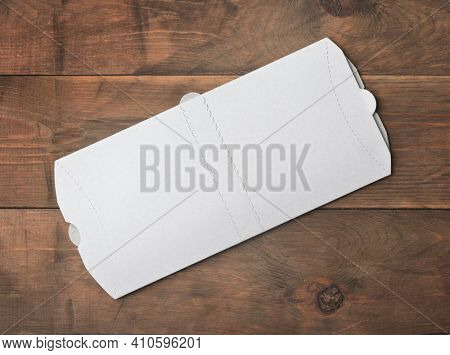 Top view of white blank new folded donner kebab paper packaging on wooden background