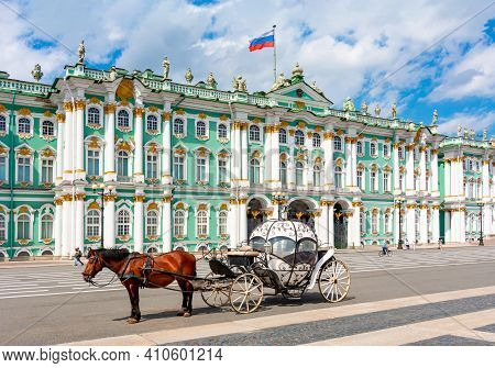 Horse Carriage On Palace Square And Hermitage Museum At Background, Saint Petersburg, Russia