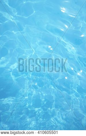 Surface Of Blue Swimming Pool. Background Of Blue Ripped Water In Swimming Pool