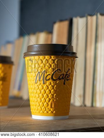 Ukraine, Kyiv - February 17, 2021: Yellow Glass Of Coffee From Mcdonald's. Paper Glass Drink Mccafe.