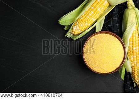Cornmeal In Bowl And Fresh Cobs On Black Table, Flat Lay