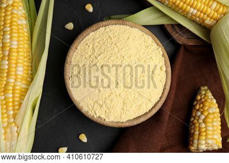 Corn Flour In Bowl And Fresh Cobs On Black Table, Flat Lay