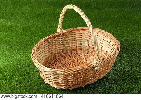 New Empty Wicker Basket On Green Lawn. Easter Item