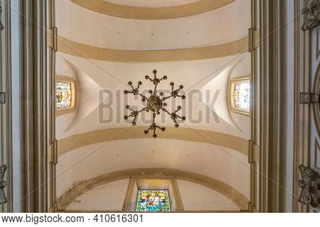 Dubrovnik, Croatia - Aug 20, 2020: Ceiling View Of Droplight And Stained Glasses In St. Ignatius Chu