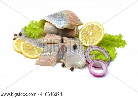 Atlantic Salted Herring Fillet With Onion Ring, Lemon, And Pepper, Isolated On A White Background