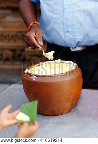Indian Hindu Distributing Prasad Butter To Devotees To Eat As Blessed Food By God During Krishnastam