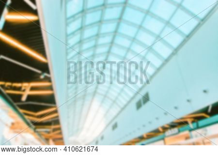 Bokeh Shopping Mall Background. Interior Of Retail Centre Store In Soft Focus. People Shopping In Mo