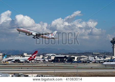 LOS ANGELES, CA - OCTOBER 23: An American Airlines passenger jet takes off from Los Angeles International Airport (LAX) in Los Angeles, CA on October 23, 2012. American may merge with US Airways.