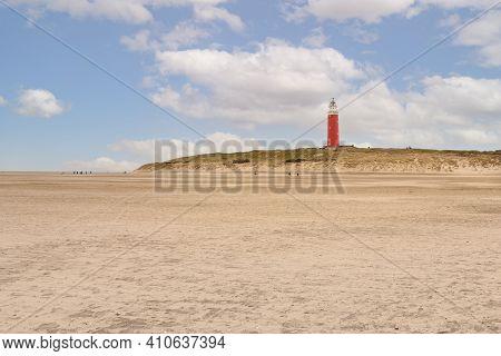 Sandy Beach And Lighthouse Called