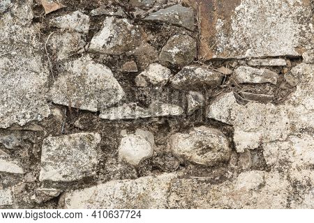 Stone Wall Of An Old House In A Village In Southern Andalusia In Spain