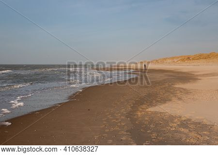 Walking Along The North Sea Beach And The Dunes On The Wadden Island Of Texel On A Beautiful Sunny W
