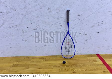 Squash Racket And Ball At Court In Training Club. Sports Equipment And Sportswear For Playing Squash